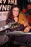 June Carter Cash with guitar